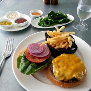 Classic Hamburger with a side of sauteed mustard greens.